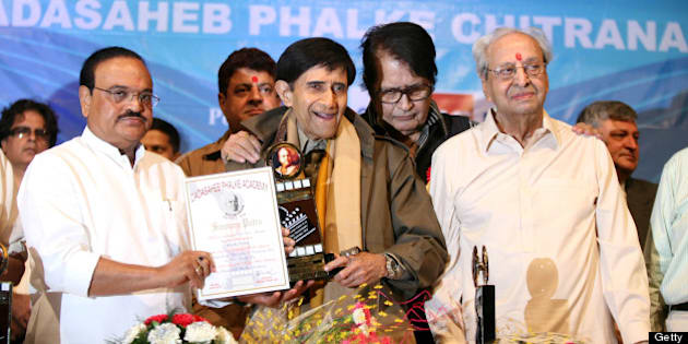 MUMBAI, INDIA  APRIL 30: (File Picture) Politician Chaggan Bhujbal, Dev Anand, Manoj Kumar and Pran at the felicitation of Dev Anand on Dadasaheb Phalke Awards Ceremony at Bhaidas Hall Vile Parle on April 30, 2010 in Mumbail, India. Veteran Bollywood actor Pran, who made a mark for himself portraying strong negative and supporting roles, passed away at the age of 93 on Friday evening after prolonged illness. Born on February 12, 1920, Pran has been known for remarkable roles in Bollywood hits like Zanjeer, Don, Amar Akbar Anthony, Upkaar, Parichay and Sharaabi among hundreds others. (Photo by Puneet Chandhok/Hindustan Times via Getty Images )
