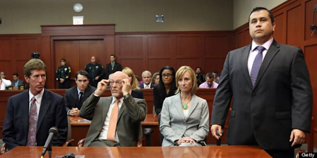 SANFORD, FL - JULY 13:  George Zimmerman (R) stands as the jury arrives to deliver the verdict, on the 25th day of his trial at the Seminole County Criminal Justice Center July 13, 2013 in Sanford, Florida. Zimmerman was found not guilty of second-degree murder in the 2012 shooting death of Trayvon Martin.  (Photo by Joe Burbank-Pool/Getty Images)