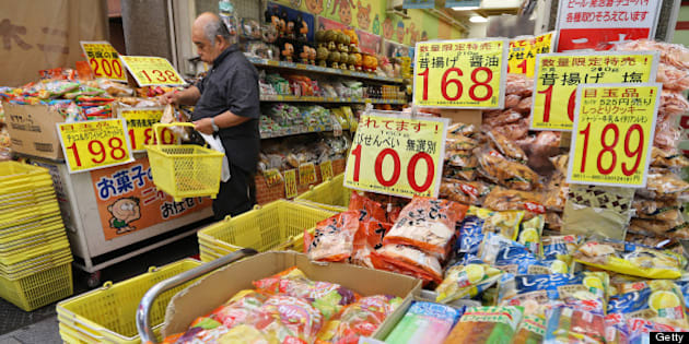 A man puts a package of snacks in a grocery basket at Ameyoko market in Tokyo, Japan, on Friday, May 31, 2013. The national price gauge fell 0.4 percent in April, matching the median estimate of 29 economists in a Bloomberg News survey. Photographer: Yuriko Nakao/Bloomberg via Getty Images
