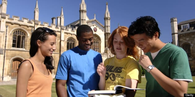 Students in the grounds of the Corpus Christi College, founded by Cambridge residents in 1352, Cambridge, Cambridgeshire, England.