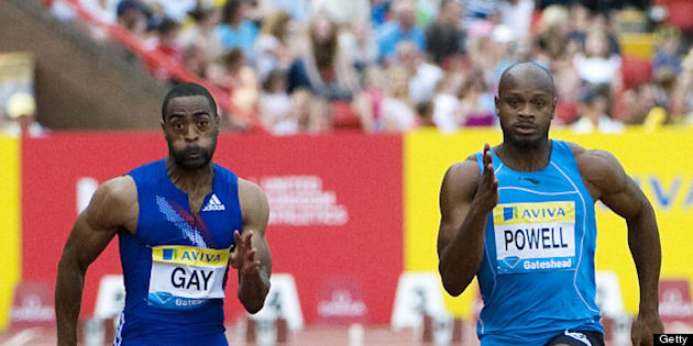 US Tyson Gay (L) runs to win the battle against Jamaica's Asafa Powell (R) in the mens 100m final at the Aviva British Grand Prix on July 10, 2010. AFP PHOTO/Derek Blair (Photo credit should read Derek Blair/AFP/Getty Images)