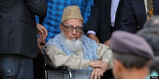 Former head of opposition Jamaat-e-Islami party Ghulam Azam  (C) escorted by security personnel and lawyers as he emerges from the Bangladesh International Crimes Tribunal in Dhaka on January 11, 2012.  Bangladesh arrested an Islamist leader on charges of war crimes during the country's 1971 liberation struggle against Pakistan, lawyers said.  AFP PHOTO/ Munir uz ZAMAN (Photo credit should read MUNIR UZ ZAMAN/AFP/Getty Images)