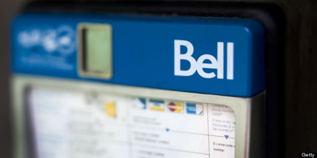A Bell Canada pay phone stands in this photograph taken with a tilt-shift lens in Toronto, Ontario, Canada, on Thursday, July 28, 2011. Bell is Canada's largest communications company, providing telephone services, mobile communications, high-speed Internet and digital television. Photographer: Brent Lewin/Bloomberg via Getty Images