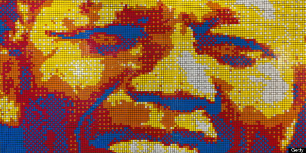 CAPE TOWN, SOUTH AFRICA - JULY 13: (SOUTH AFRICA OUT) A mosaic portrait of former South African President Nelson Mandela made entirely out of Rubik's Cubes by Jan Du Plessis stands at the entrance of  Mandela Rhodes Place Hotel & Spa on July 13, 2011 in Cape Town, South Africa. It is part of a display of the Life and Times of Nelson Mandela. (Photo by Foto24/Gallo Images/Getty Images)