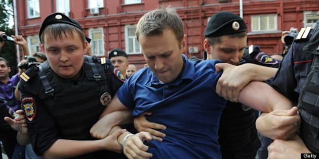 Police officers detain Russia's top opposition figure Alexei Navalny (C) after his visit the city's election commission office to submit documents to get registered as a mayoral election candidate in Moscow July 10, 2013. Police detained today  Navalny on a charge of organizing an unauthorized rally near the city's election commission office but later he was released. AFP PHOTO / VASILY MAXIMOV        (Photo credit should read VASILY MAXIMOV/AFP/Getty Images)