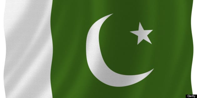 Flag of pakistan waving with highly detailed textile texture pattern