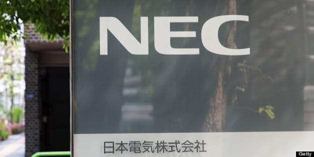 NEC Corp.'s logo is displayed in front of the company's headquarters in Tokyo, Japan, on Friday, April 26, 2013. NEC, a Japanese maker of wireless base stations, will get 130 billion yen ($1.3 billion) of financial support from lenders and sell its stake in a mobile phone sales unit to Marubeni Corp. Photographer: Noriyuki Aida/Bloomberg via Getty Images