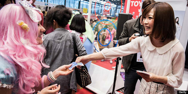PARIS, FRANCE - JULY 06:  Singer May'n attend a talk and autograph session at the 'TOYOTA x STUDIO4AC meets ANA PES' booth during the Japan Expo at Paris-nord Villepinte Exhibition Center on July 6, 2013 in Paris, France.  (Photo by Francois Durand/Getty Images for Toyota)