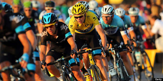 PARIS, FRANCE - JULY 21: Chris Froome of Great Britain and SKY Procycling (C) rides in the wheel of teammate Richie Porte of Australia during the twenty first and final stage of the 2013 Tour de France, a processional 133.5KM road stage ending in an evening race around the Champs-Elysees, on July 21, 2013 in Paris, France.  (Photo by Bryn Lennon/Getty Images)