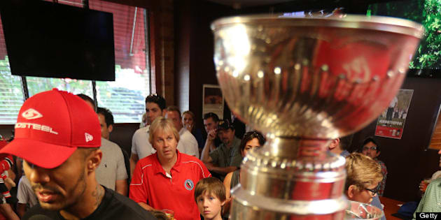 TORONTO, ON- JULY 13  - Philip Pritchard, one of three keepers of the puck looks on as former Chicago Blackhawk, now a Flyer, Ray Emery brings the Stanley Cup to Wayne Gretzky's restaurant  in Toronto,   July 13, 2013.        (Steve Russell/Toronto Star via Getty Images)