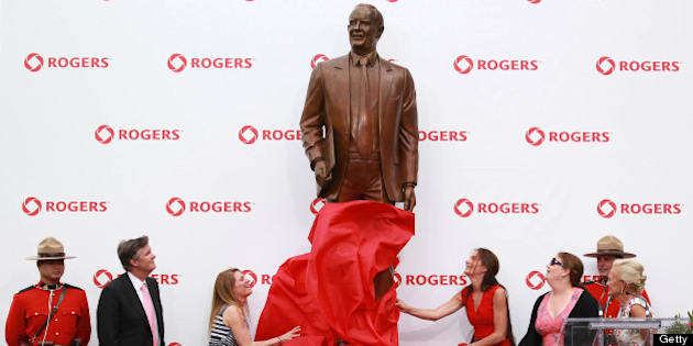 TORONTO, ON- JULY 23  - the  A ststue of Ted Rogers is unveiled by his wife and children outside the Rogers Centre,   July 23, 2013.        (Steve Russell/Toronto Star via Getty Images)