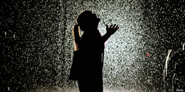 A visitor at the 'Rain Room'  at MOMA ( The Museum of Modern Art ) May 20, 2013. MoMA PS1 is presenting as part of a major component of EXPO 1: New York, a exhibit entitled Rain Room (2012), which will be presented at The Museum of Modern Art, from May 12 through July 28, 2013. A large-scale environment by Random International, Rain Room is a  field of falling water that pauses wherever a human body is detected?offering visitors the experience of controlling the rain.  'MANDATORY MENTION OF THE ARTIST UPON PUBLICATION' AFP PHOTO / TIMOTHY CLARY        (Photo credit should read TIMOTHY CLARY/AFP/Getty Images)