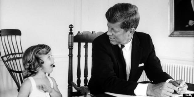 Sen. John Kennedy chatting w. his young daughter Caroline as he goes over some papers on table at his Georgetown home.  (Photo by Alfred Eisenstaedt//Time Life Pictures/Getty Images)