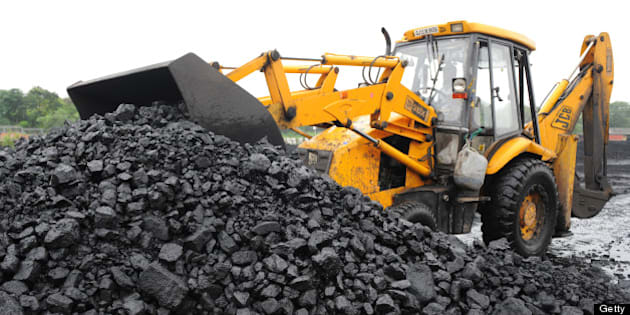 An Indian truck driver prepares to load coal onto a truck at the Kankaria Railway yard in Ahmedabad on July 20, 2013. In 1973, India nationalised its coal industry and created state-run giant Coal India. Then in 1993 it allowed private companies to mine coal for their own use when state output could not supply demand.  AFP PHOTO / Sam PANTHAKY        (Photo credit should read SAM PANTHAKY/AFP/Getty Images)