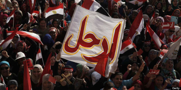 CAIRO, EGYPT - JUNE 30:   Egyptian opposition protesters chant during a demonstration in Tahrir Square as part of the 'Tamarod' campaign on June 30, 2013 in Cairo, Egypt. Crowds of pro- and anti-Morsi protesters gathered in locations across Egypt on June 30, the day of a series of nation-wide mass demonstrations entitled 'Tamarod', or 'Rebel', planned to take place on the first anniversary of Morsi's election to the Egyptian Presidency. The 'Tamarod' campaign, organised by a coalition of opposition political groups, aims to bring down the government of President Morsi through country-wide demonstrations. (Photo by Ed Giles/Getty Images).
