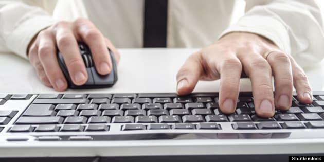 closeup of a man using computer....