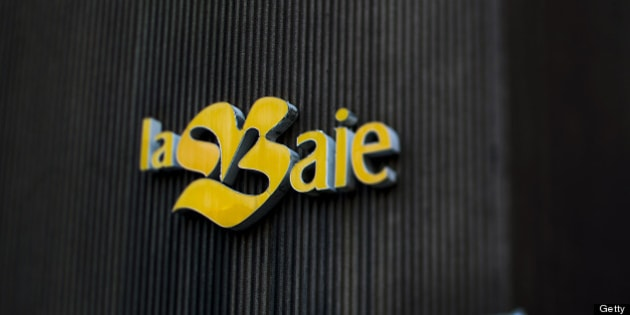 The Bay signage is displayed in this photo taken with a tilt-shift lens outside of a department store stands in Montreal, Quebec, Canada, on Saturday, Nov. 5, 2011. The Bay, known as la Baie in French, is a chain of 91 department stores that operate across parts of Canada with a focus on fashion apparel, accessories, and home goods. Photographer: Brent Lewin/Bloomberg via Getty Images