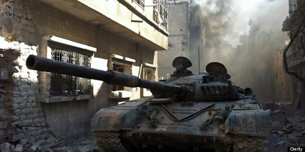 A government forces tank is seen in the Khalidiyah neighbourhood of Syria's central city of Homs on July 28, 2013. Government forces bolstered by Lebanese Shiite militiamen were poised to retake the largest rebel-held district of Syria's third city Homs, a watchdog and state media said. AFP PHOTO/STR        (Photo credit should read STR/AFP/Getty Images)