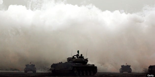 GOTENBA, JAPAN - AUGUST 23:  Tanks fire shells during the annual Japan's Self Defense Forces live-firing exercise at the Higashi Fuji training facility on August 23, 2007 in Gotenba, Japan. The post-war constitution restricts Japan from having military forces sufficient to lead war. Self Defense Forces, created strictly to maintain peace and safety, operate with nearly 240,000 personnel.  (Photo by Junko Kimura/Getty Images)