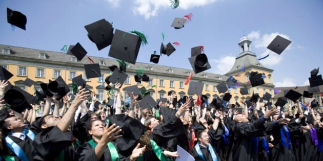 GERMANY, BONN - JULY 6:  Graduates with robes and birettas are throwing their birettas into the air at the 9th celebration of the Rheinische-Friedrich-Wilhelms University in Bonn at July 6, 2013 in Bonn, Germany. (Photo by Ulrich Baumgarten via Getty Images)