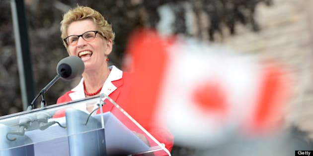 TORONTO, ON - JULY 1:  Ontario Premier Kathleen Wynne and Honourable Michael Coteau , Minister of Citizenship and Immigration(black man in backround) greets the crowd on Canada's Day at Queens Park.        (Vince Talotta/Toronto Star via Getty Images)