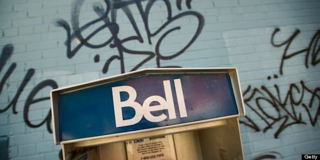 TORONTO, ON - JULY 16 :  Bell Pay Phones may soon become a thing of the past now that the CRTC has denied raising the usage charge. Mobile phones have made pay phones somewhat obsolete, or severely underused. These two on the corner of Boston Avenue and Queen Street East stand against graffiti on a building wall.        (Rick Madonik/Toronto Star via Getty Images)