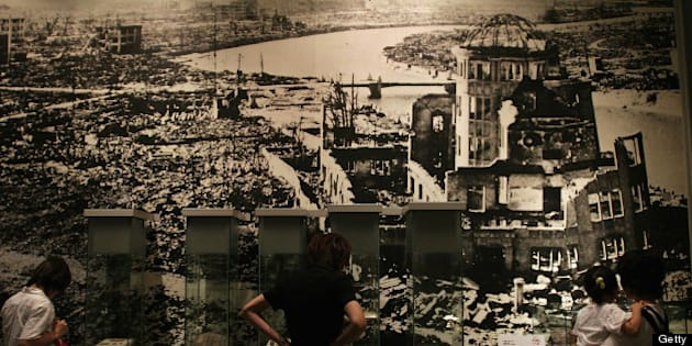 HIROSHIMA, JAPAN - JULY 27:  Visitors look at a picture, showing the aftermath of the atomic bomb attack, at the museum ahead of the 60th anniversary of the dropping of the first atomic bomb at the Hiroshima Peace Memorial Park on July 27, 2005 in Hiroshima. Japan. Hiroshima will mark the 60th anniversary on August 6. (Photo by Junko Kimura/Getty Images)