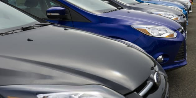 New cars sit on display for sale at the Serramonte Ford Motor Co. dealership in Colma, California, U.S., on Friday, March 29, 2013. Domestic vehicle sales data is expected to be released April 2. U.S. light-vehicle sales probably climbed 4.2 percent in March to 1.46 million, the average estimate of 10 analysts surveyed by Bloomberg. Photographer: David Paul Morris/Bloomberg via Getty Images
