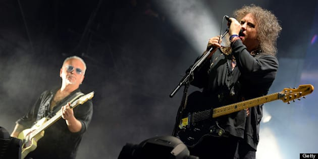 CHICAGO, IL - AUGUST 04:  Reeves Gabrels and  Robert Smith of The Cure perform during Lollapalooza 2013 at Grant Park on August 4, 2013 in Chicago, Illinois.  (Photo by Theo Wargo/Getty Images)