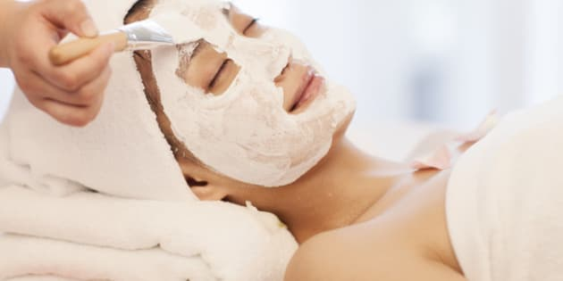 Spa workers wipping mask to an Asian woman's face