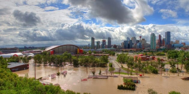[UNVERIFIED CONTENT] A panoramic view of the flooded stampede grounds. Image was taken on June 21st at approximately 2pm. The Saddledome (Calgary flames) was full of water up to row 10 and the Calgary downtown core was also flooded.   Bow River normal water levels are approx. 250 cubic meters per second...during the flood the Bow River was at 1,458 cu meters per second.  The Elbow river running through Calgary on the south central part of the city was flooding simultaneously as the Bow River was flooding this caused a perfect storm, when both rivers breached, the inner city of Calgary was lost as well as any communities that were along both rivers...devastating and heart breaking for the residents residing in these areas.  Calgary and southern Alberta have been devastated by a flood in June 2013.  Calgary, Alberta