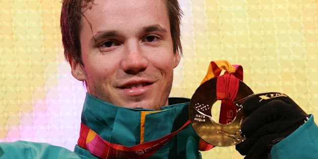 TURIN, ITALY - FEBRUARY 16:  Dale Begg-Smith of Australia presents his gold medal during the Medals Ceremony during Turin 2006 Winter Olympic Games on February 16, 2006 at the Medals Plaza in Turin, Italy. (Photo by Vladimir Rys/Bongarts/Getty Images)