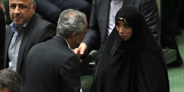 Iranian Vice President for legal matters Elham Aminzadeh (R) attends parliament session to discuss the President's proposed cabinet in Tehran on August 12, 2013. Iran's parliament began debating the 18-member cabinet proposed by President Hassan Rowhani ahead of a vote of confidence later this week.  AFP PHOTO/ATTA KENARE        (Photo credit should read ATTA KENARE/AFP/Getty Images)