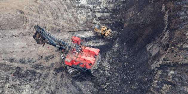 A large power shovel excavates heavy oil loaded sand from a Alberta Oilsands open pit mine near Fort McMurray.