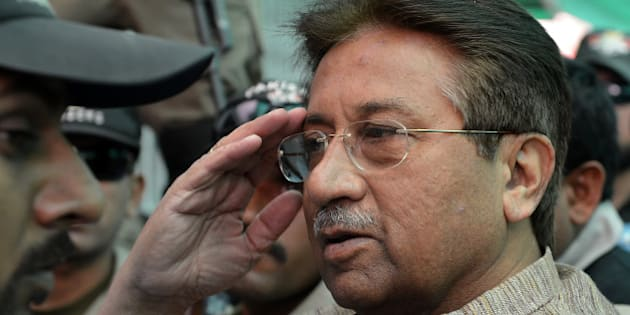 Former Pakistani president Pervez Musharraf (C) is escorted by soldiers as he salutes on his arrival at an anti-terrorism court in Islamabad on April 20, 2013. A Pakistani anti-terrorism court on April 20 extended former military ruler Pervez Musharraf judicial remand to prison for two weeks for sacking judges during his rule, officials said. AFP PHOTO / AAMIR QURESHI        (Photo credit should read AAMIR QURESHI/AFP/Getty Images)