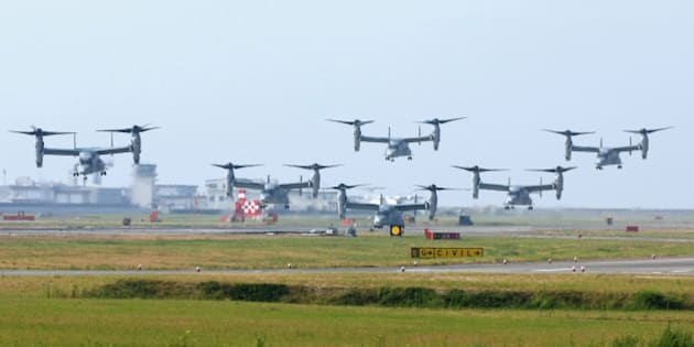 IWAKUNI, JAPAN - AUGUST 12:  (CHINA OUT, SOUTH KOREA OUT) MV-22 Osprey aircrafts take off at the U.S. Marine Corps Iwakuni Air Station in Yamaguchi Prefecture heading for the U.S Marine Corps' Futenma Air Station in Okinawa prefecture on August 12, 2013 in Iwakuni, Japan.  (Photo by The Asahi Shimbun via Getty Images)