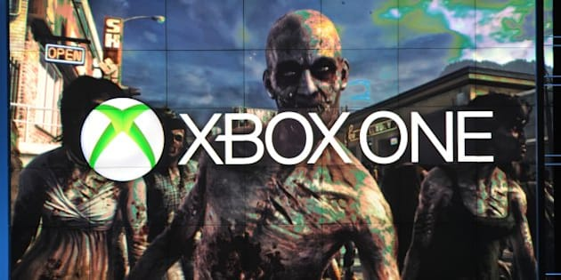 A frame from Dead Rising 3, exclusively for Xbox One, is seen under the Xbox One logo, at the Microsoft Xbox E3 2013 Media Briefing in Los Angeles on June 10, 2013. The press conference precedes the Electronic Entertainment Expo (E3) which takes place in Los Angeles June 11-13.   AFP PHOTO / ROBYN BECK        (Photo credit should read ROBYN BECK/AFP/Getty Images)