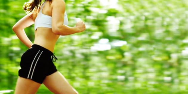 beautiful young woman runner in ...