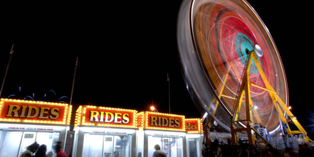 CNE at Night-- 08/24/2006 --The Ferris Wheel spins round while people try and purchase tickets for the many rides at the CNE on August 24, 2006. (Photo by Carlos Osorio/Toronto Star via Getty Images)