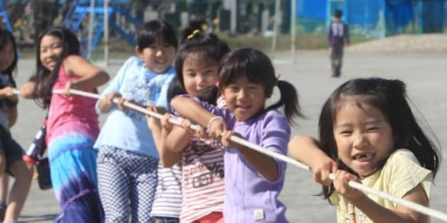 ISHINOMAKI, JAPAN - OCTOBER 23: (JAPANESE NEWSPAPERS OUT) Children play at elementary school on October 23, 2011 in Ishinomaki, Miyagi, Japan. The event takes place regularly for children who lost place to play in the quake. (Photo by Sankei/Sankei via Getty Images)