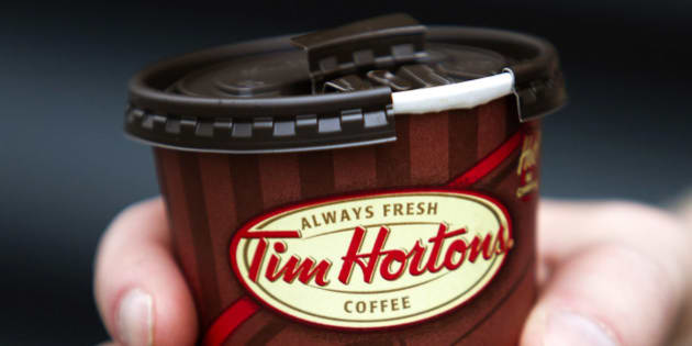 A cup of Tim Hortons Inc. coffee is displayed for a photograph in Toronto, Ontario, Canada, on Wednesday, Aug. 3, 2011. Tim Hortons Inc. is a chain of franchise fast food restaurants that serve coffee drinks, tea, soups, sandwiches, donuts, bagels, and pastries. Photographer: Brent Lewin/Bloomberg via Getty Images
