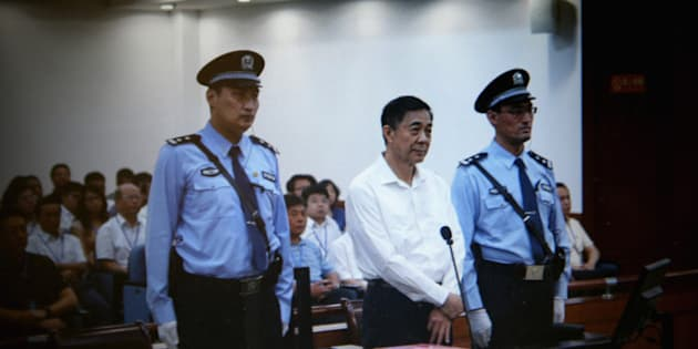 JINAN, CHINA - AUGUST 22:  A screen shows the picture of the trial of disgraced Chinese politician Bo Xilai (Center) before a press conference in Jihua Hotel on August 22, 2013 in Jinan, China. Former Chinese politician Bo Xilai is standing trial on charges of bribery, corruption and abuse of power. Bo Xilai made global headlines last year when his wife wife Gu Kailai was charged and convicted of murdering British businessman Neil Heywood.  (Photo by Feng Li/Getty Images)