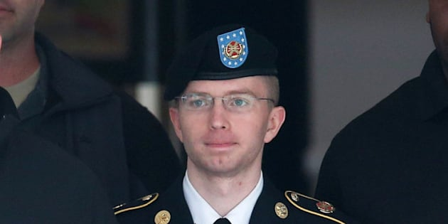 FORT MEADE, MD - AUGUST 20:  US Army Private First Class Bradley Manning is escorted out of a military court facility during the sentencing phase of his trial August 20, 2013 in Fort Meade, Maryland. Manning was found guilty of several counts under the Espionage Act, but acquitted of the most serious charge of aiding the enemy.  (Photo by Mark Wilson/Getty Images)