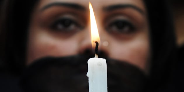 Indian members of a social organisation Our City Our Right holds a candle during a silent protest following the recent gang rape and murder of a 20-year-old college student in Barasat, in Kolkata on June 15, 2013. Activists and social groups in various parts of the state held rallies and protests following the incident.  AFP PHOTO/ Dibyangshu SARKAR        (Photo credit should read DIBYANGSHU SARKAR/AFP/Getty Images)