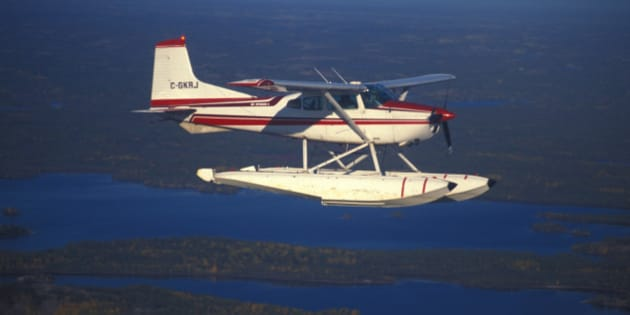 A Cessna 185 flies above the Northwest Territories.