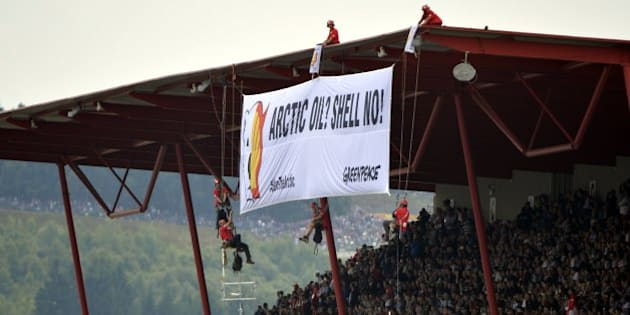 Greenpeace militants deploy a banner reading 'ARCTIC OIL? SHELL NO!' during a protest against Shell, one of the main sponsors of the F1 Grand Prix, at the Spa-Francorchamps circuit in Spa on August 25, 2013 during the Belgium Formula One Grand Prix.    AFP PHOTO / BELGA / ERIC LALMAND        (Photo credit should read ERIC LALMAND/AFP/Getty Images)