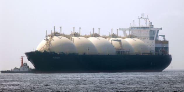 JAPAN - JUNE 20:  A liquefied-natural-gas (LNG) tanker, leaves a berth in Yokohama City, Kanagawa Prefecture, Japan, on Saturday, June 20, 2009. The world LNG market is likely to face supply shortages around 2013 as new projects fail to keep pace with supply, according to Wood Mackenzie, a U.K. energy research and consulting company.  (Photo by Kimimasa Mayama/Bloomberg via Getty Images)