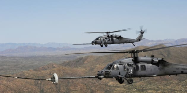 April 15, 2010 - Two HH-60 Pave Hawks refuel over the desert surrounding Davis-Monthan Air Force Base, Arizona, during Angel Thunder 2010.