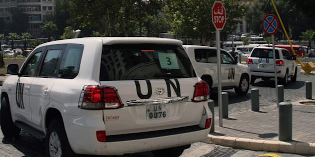 A convoy of United Nations (UN) vehicles leave a hotel in Damascus on August 26, 2013 carrying UN inspectors travelling to the site of a suspected deadly chemical weapon attack the previous week in Ghouta, east of the capital. The Syrian authorities approved the UN inspection of the site, but US officials said it was too little, too late, arguing that persistent shelling there in recent days had 'corrupted' the site.  AFP PHOTO / STR        (Photo credit should read STR/AFP/Getty Images)