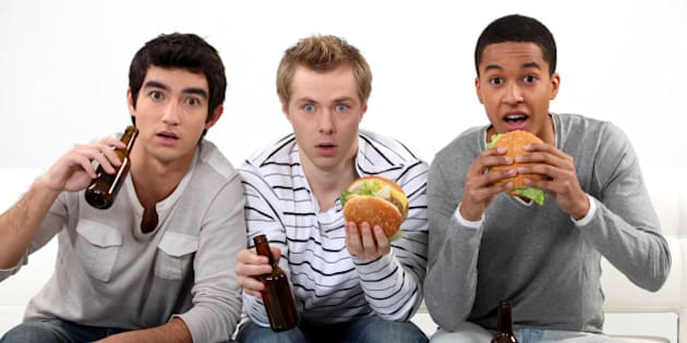 male friends eating burgers and ...